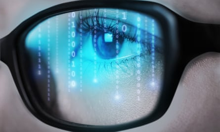 An eye behind glasses looking at a blue screen with numbers on it