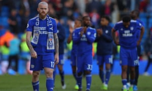 Aron Gunnarsson cuts a dejected figure following Cardiff City's relegation after losing at home to Crystal Palace.