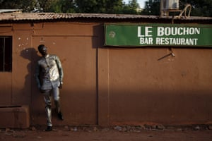 Model Mamadou Racine poses for a picture in a bazin suit made by designer Barros Coulibaly