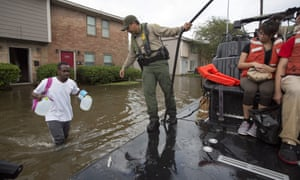 US Border Patrol agents evacuate residents from a neighbourhood flooded by rising waters.