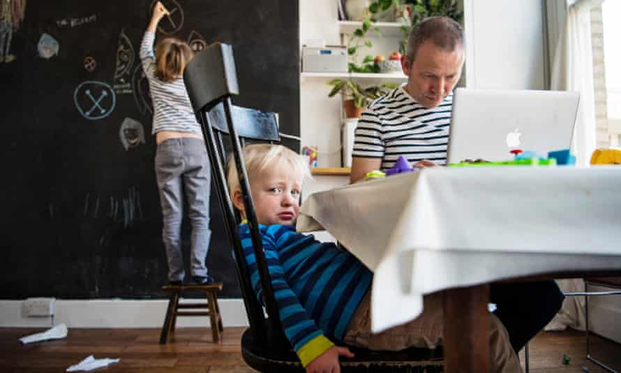 Parent working from home with children.