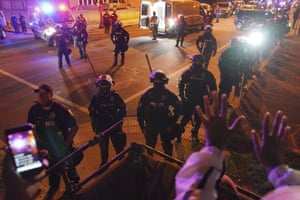 Police set up a line outside the First Unitarian church on Thursday in Louisville.