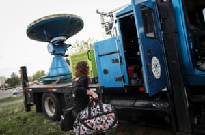At the Center for Severe Weather Research headquarters in Boulder, Colorado, research meteorologist Karen Kosiba loads gear into the Doppler on Wheels (DOW) vehicle. DOW is a mobile doppler radar mounted on a truck that brings instruments directly into storms, allowing scientists to scan tornadoes and make 3-D maps of wind and debris.