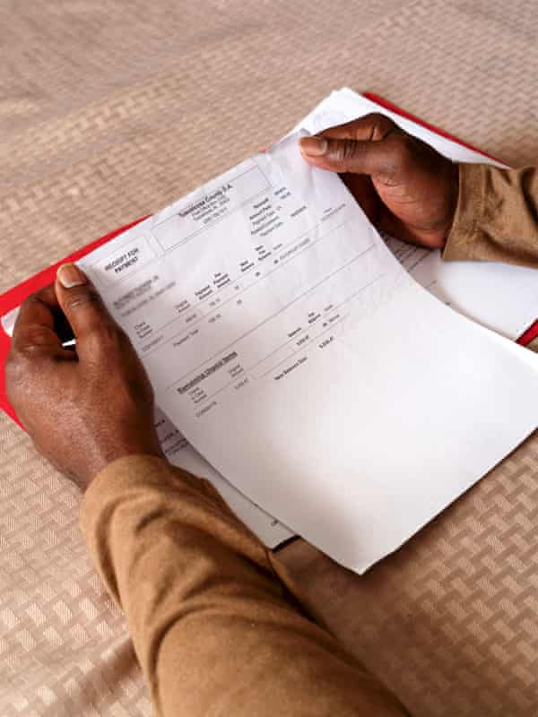 Alfonzo Tucker holds his receipt for payment showing he paid the amount owed to restore his voting rights.