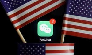 Messenger app WeChat, seen among US flags.