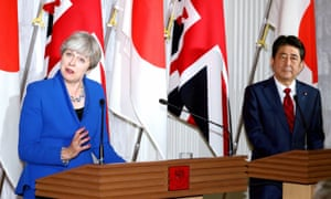 Theresa May, pictured with Shinzo Abe