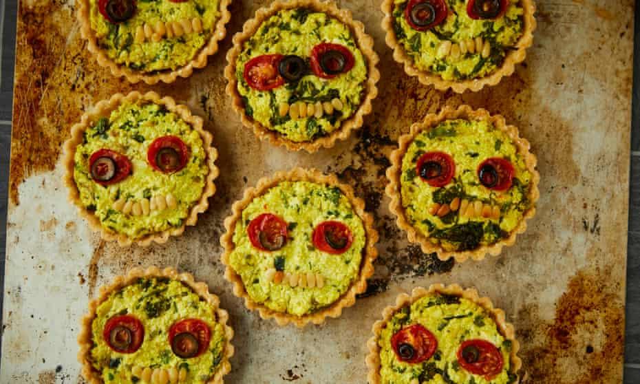 Vegan tofu tarts with broccoli, onion and pine nuts.