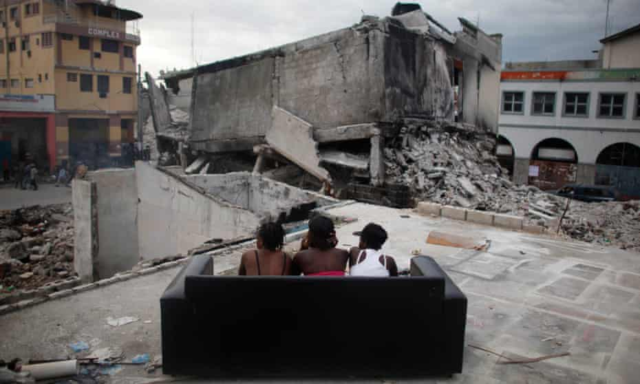 In an image from June 2010, sex workers wait for clients among the debris of homes destroyed by the earthquake in Port-au-Prince