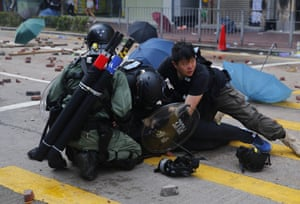 Riot police officers detain a pro-democracy protester during clashes