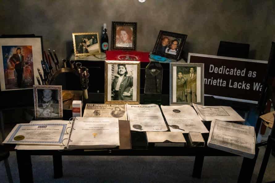 Alfred Lacks-Carter Jr displays memorabilia of his grandmother, Henrietta Lacks, in the living room of his home near Baltimore, 23 June 2021.