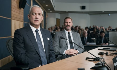 Hanks and Eckhart face investigators in the film.