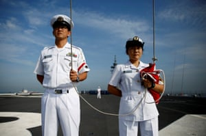 A male and female crew of the Japan Maritime Self-Defence Force