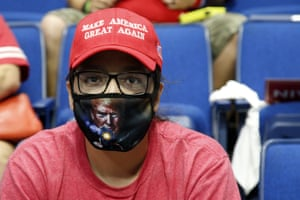 Tulsa, US A Trump supporter wears a mask at a campaign rally in Oklahama