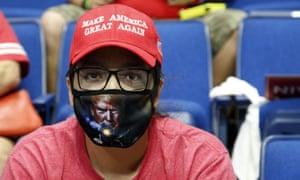 This Oklahoman, at a Trump rally in Tulsa on 20 June, was ahead of the governor's recommendation to wear masks.