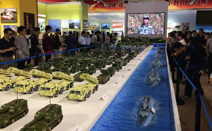 No fewer than 24 large photographs of Xi Jinping are on display in the military section of the Five Years On exhibition.