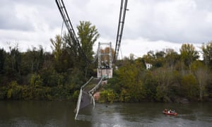 Rescue workers at the scene of the collapsed bridge