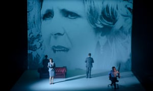 Rebecca Caine, left, as Iris Robinson (whose image is projected as backdrop), with Tony Flynn, right, as Radio Ulster's Stephen Nolan, in Abomination: A DUP Opera at the Lyric theatre, Belfast.