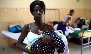 A mother holds her baby at Kisenyi health centre