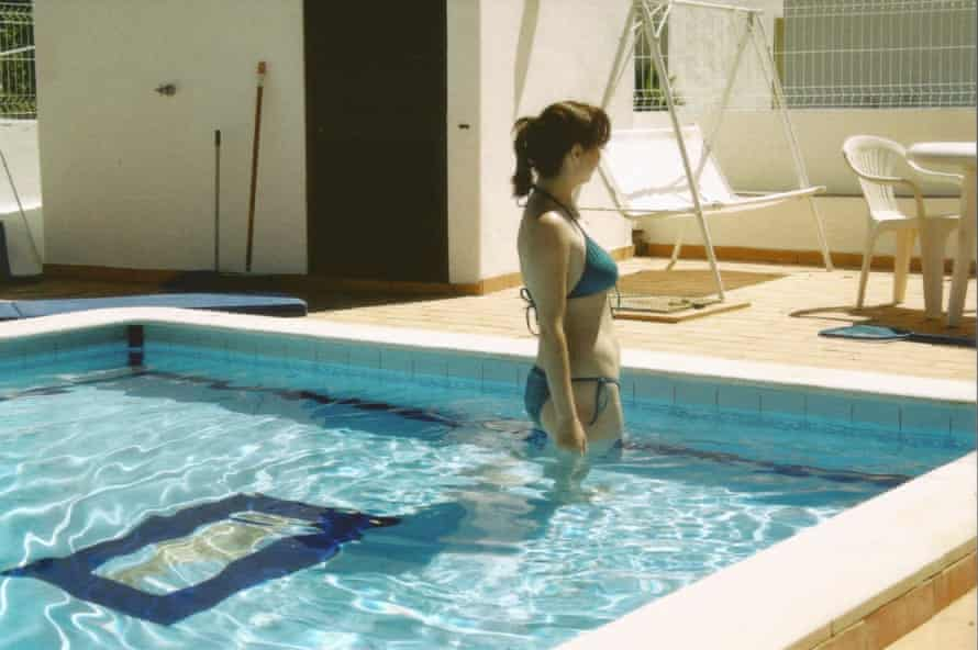 A woman in a swimming pool.