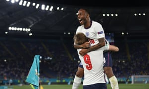 Harry Kane of England celebrates with Raheem Sterling after scoring their side's third goal.