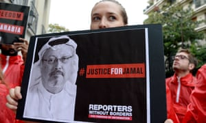 Members of Reporters Without Borders gather outside the Saudi consulate in Paris to mark the first anniversary of the murder of Jamal Khashoggi
