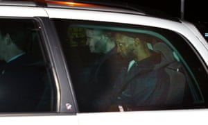 Jamal al-Harith, right, leaves Northolt RAF base, on 9 March 2004 with plain-clothes police officers after being released from custody.