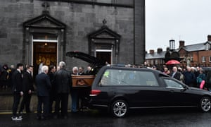 The family of Dolores O'Riordan carry her coffin into St Joseph's church in Limerick on Sunday.