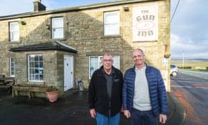 Residents and fundraisers John Bassett, left, and Graham Green outside the Gun Inn.