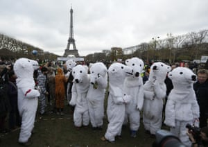 People dressed as polar bears demonstrate near the Eiffel Tower in Paris, during COP21.