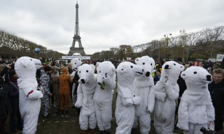 Environmental protesters gather near the Eiffel Tower in Paris during climate change talks in 2015