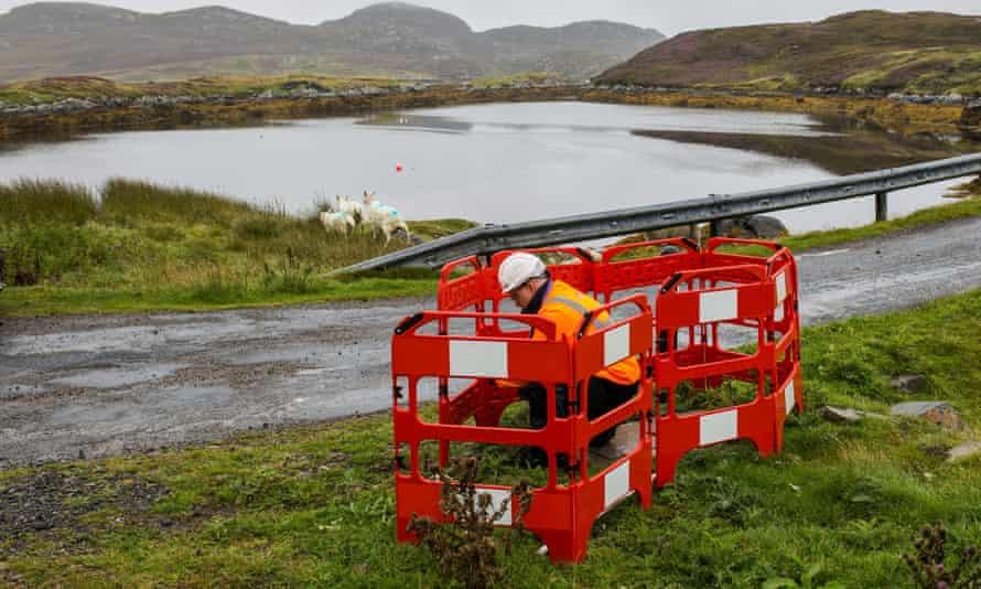 An engineer works on a full-fibre broadband link on Grimsay, Outer Hebrides