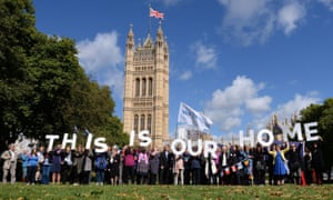 EU citizens holding up a banner after lobbying MPs to guarantee their post-Brexit rights.