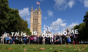 EU citizens holding up a banner after lobbying MPs to guarantee their post-Brexit rights at the Houses of Parliament in London