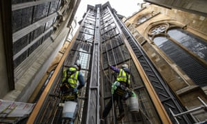 Window cleaners at work on Ptolemy Dean's new tower giving access to the triforium above Westminster Abbey's nave.