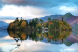Keswick, England Autumn colours are reflected in Derwentwater in Cumbria