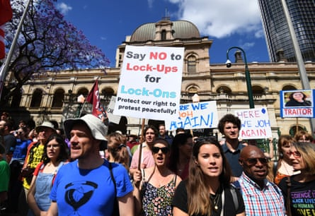 Protesters rally against proposed laws banning the use of lock-on devices in protests