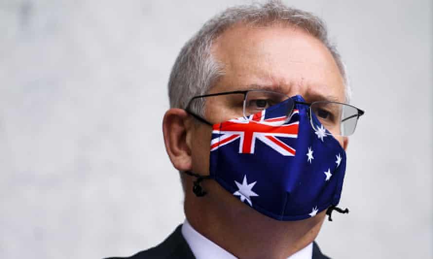 Prime minister Scott Morrison wears an Australian flag mask