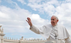 Pope Francis waves in St Peter's Square in the Vatican.