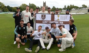 Surrey players celebrate winning at Worcestershire.