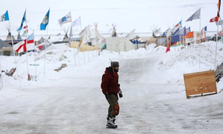 A man walks through the Dakota Access Pipeline protest camp on the edge of the Standing Rock Sioux reservation near Cannon Ball, North Dakota Tuesday.