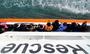 Migrants wait in May to disembark from Aquarius in the Sicilian harbour of Catania.