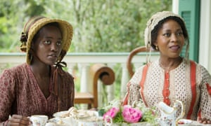 Lupita Nyong'o (left) and Alfre Woodard in 12 Years a Slave.