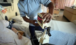A nurse tends to recovering patients on a general ward at The Queen Elizabeth Hospital in Birmingham
