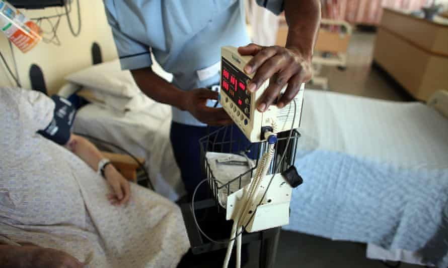 A nurse tends to patients at  Queen Elizabeth Hospital Birmingham