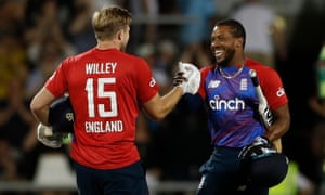 England's David Willey and Chris Jordan celebrate after winning the match.