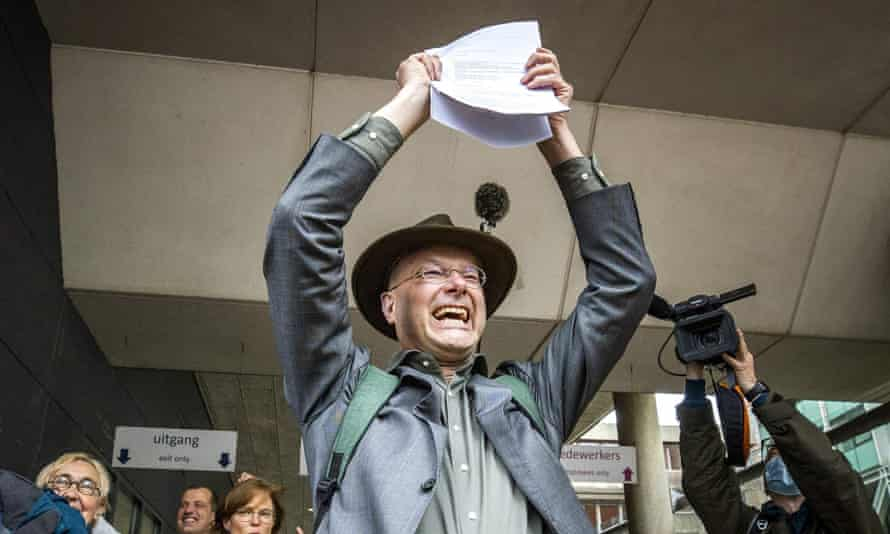 Donald Pols, director of Milieudefensie, celebrates after the ruling in The Hague.