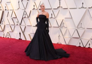 Nominated for a Star is Born, Lady Gaga continued her red carpet success in a black gown by Alexander McQueen with a crinoline, black latex gloves and a Tiffany yellow diamond, one of the largest in the world, apparently valued at $30m and last worn by Audrey Hepburn in Breakfast at Tiffany's