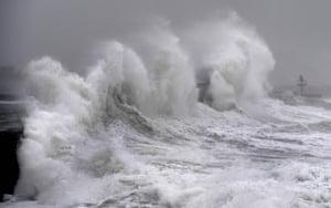 Waves lash a jetty in Plobannalec-Lesconil, western France