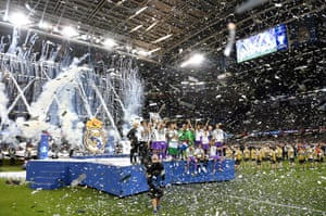 The Real Madrid team celebrate with the trophy.