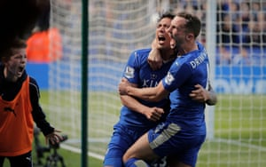 Leonardo Ulloa celebrates with Danny Drinkwater after he scored the last-minute penalty against West Ham